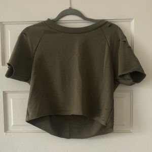 Olive cropped sweatshirt with ripped detailing